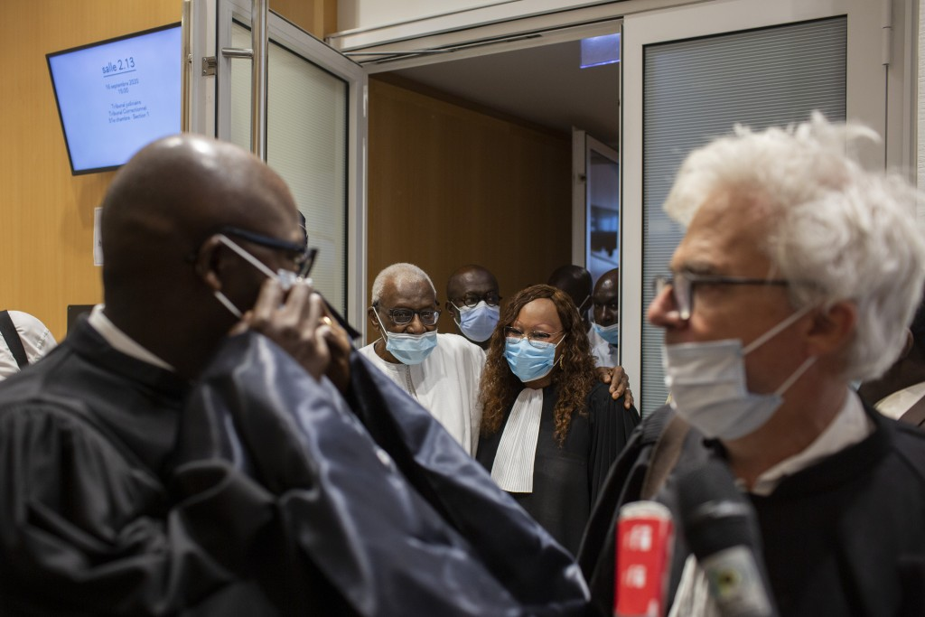 Former track federation president Lamine Diack, centre left, leaves the courtroom after his trial in Paris, France, Wednesday, September 16, 2020. Dia...