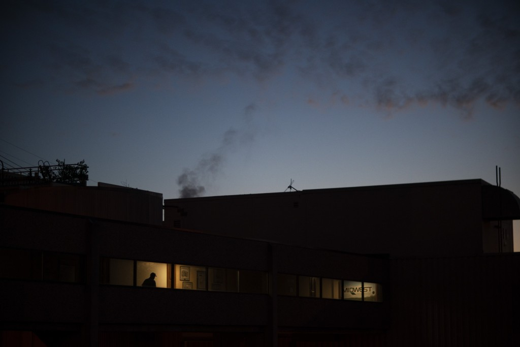 An employee walks in to Midwest Paper Group mill for a morning shift in Little Chute, Wis., part of the greater Appleton area, Aug. 18, 2020. At the m...