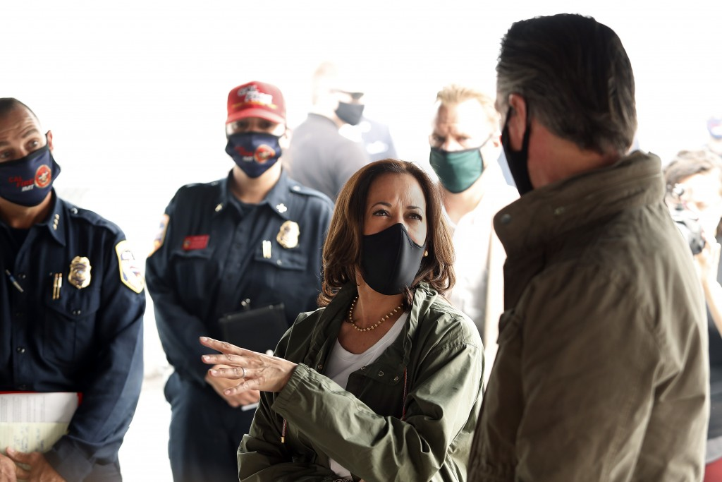 Democratic vice presidential candidate Sen. Kamala Harris, D-Calif., and California Gov. Gavin Newsom discuss the damage during the Creek Fire at Pine...