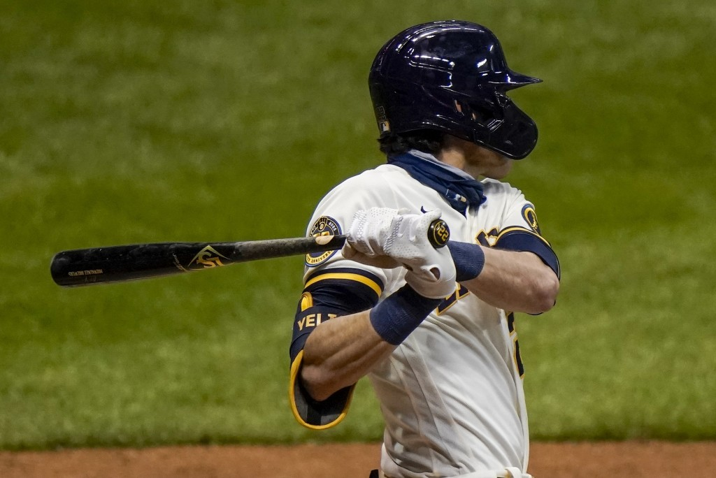 Milwaukee Brewers' Christian Yelich hits a single during the third inning of a baseball game against the St. Louis Cardinals Tuesday, Sept. 15, 2020, ...