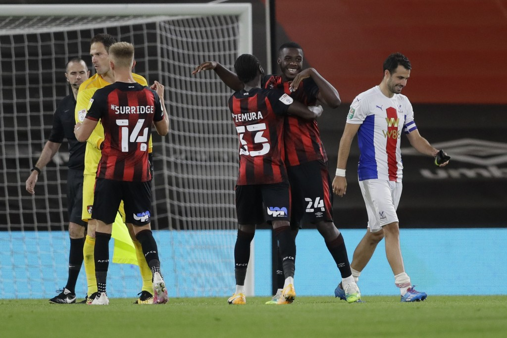 Bournemouth's Nnamdi Ofoborh, second right celebrates with Bournemouth's Jordan Zemura at the end of the English League Cup soccer match between Bourn...