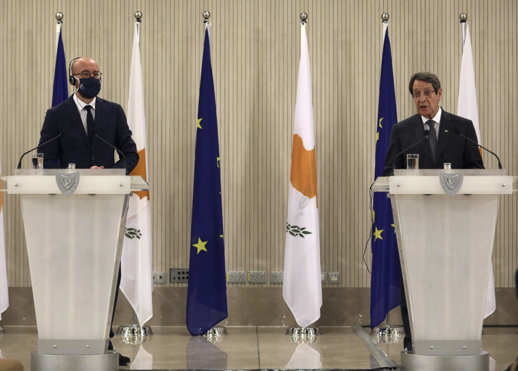 European Union Council President Charles Michel, left and and Cyprus' President Nicos Anastasiades talk to the media during a press conference, at the...