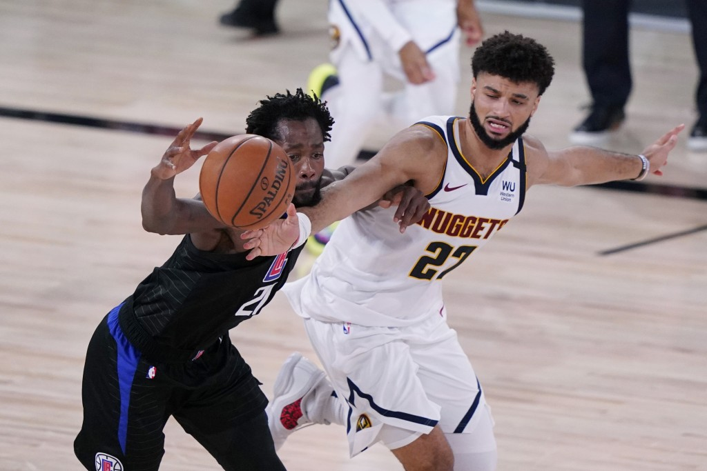 Los Angeles Clippers guard Patrick Beverley (21) is pressured by Denver Nuggets guard Jamal Murray (27) as he drives with the ball during the second h...