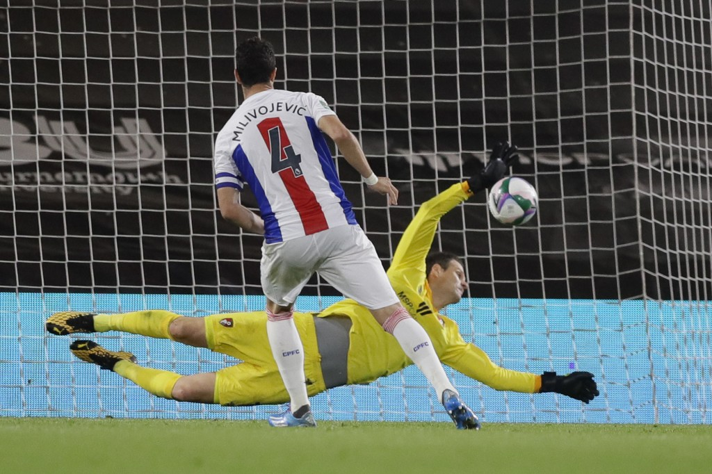 Bournemouth's goalkeeper Asmir Begovic saves Crystal Palace's Luka Milivojevic during the English League Cup soccer match between Bournemouth and Crys...