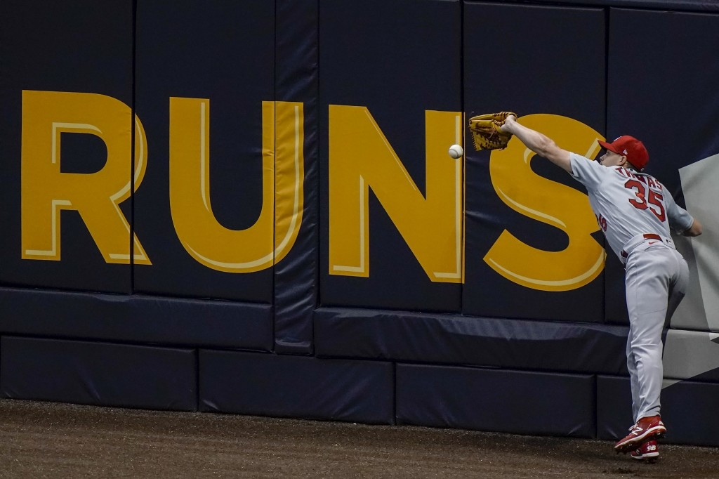 St. Louis Cardinals' Lane Thomas can't catch a ball hit by Milwaukee Brewers' Jedd Gyorko during the fifth inning of a baseball game Tuesday, Sept. 15...
