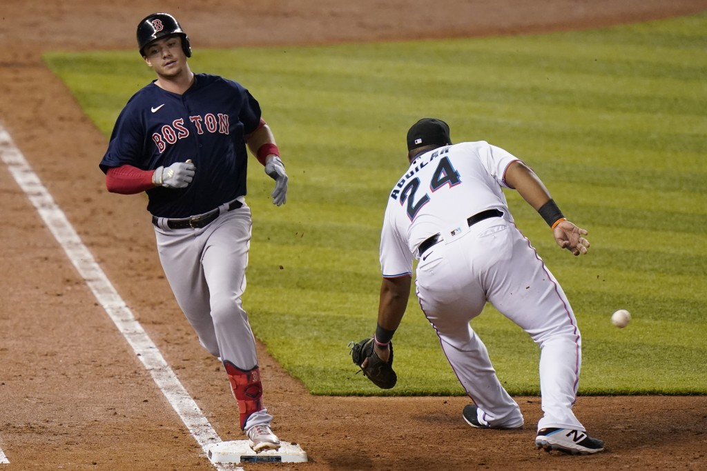 Boston Red Sox's Bobby Dalbec beats the throw to Miami Marlins first baseman Jesus Aguilar (24) for a singe during the fifth inning of a baseball game...