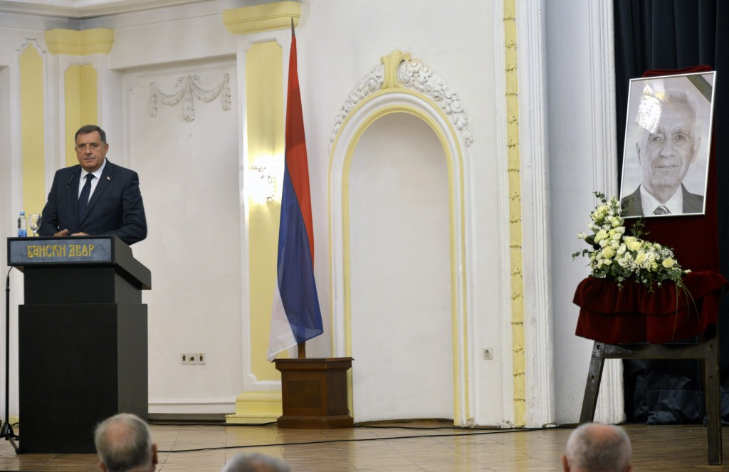 Bosnian Serb official, Milorad Dodik, who is the member of Bosnia's multi-ethnic presidency speaks during an official commemoration ceremony for Momci...
