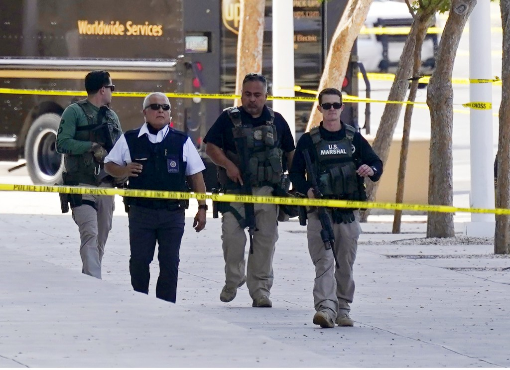 Federal law enforcement personnel patrol outside the Sandra Day O'Connor Federal Courthouse Tuesday, Sept. 15, 2020, in Phoenix. A drive-by shooting w...