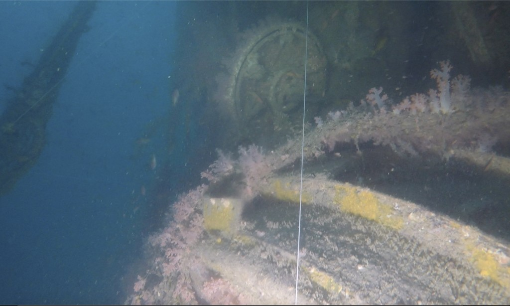 In this image taken from video, the top hatch of a conning tower can be seen from a submarine wreck somewhere in the Strait of Malacca on March 4, 202...