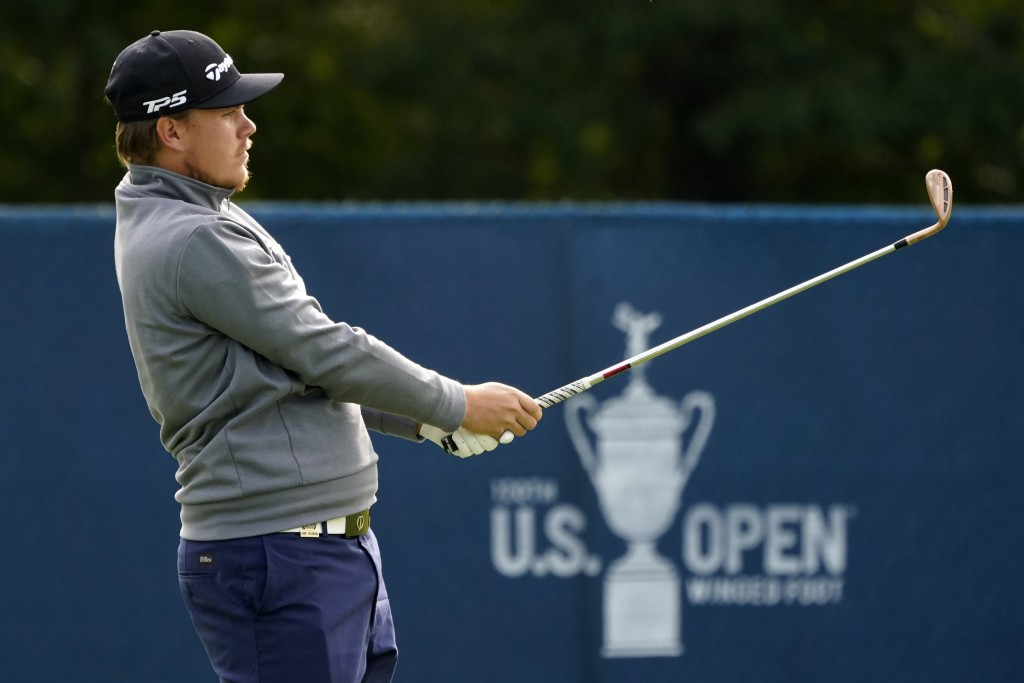 Sami Valimaki, of Finland, watches his shot while practicing for the U.S. Open Championship golf tournament, Tuesday, Sept. 15, 2020, at the Winged Fo...