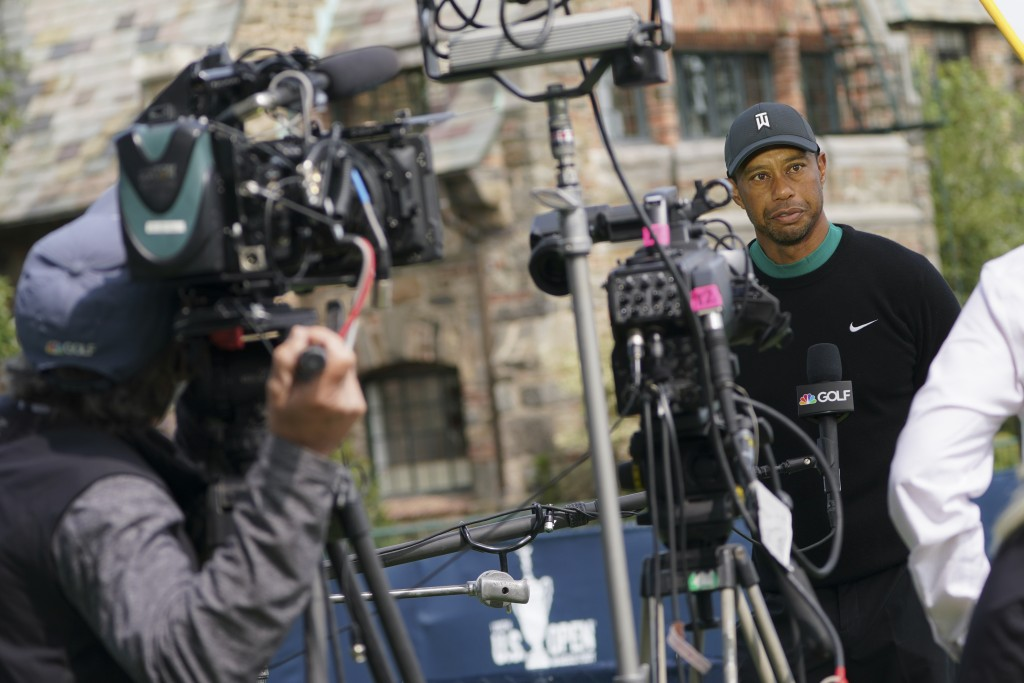 Tiger Woods is interviewed during practices before the U.S. Open Championship golf tournament at Winged Foot Golf Club, Tuesday, Sept. 15, 2020, in Ma...