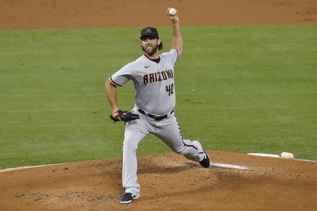Arizona Diamondbacks starting pitcher Madison Bumgarner throws during the first inning of the team's baseball game against the Los Angeles Angels on T...