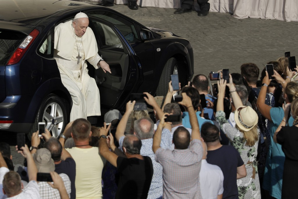 Pope Francis arrives in the St. Damaso courtyard on the occasion of his weekly general audience at the Vatican, Wednesday, Sept. 16, 2020. (AP Photo/G...