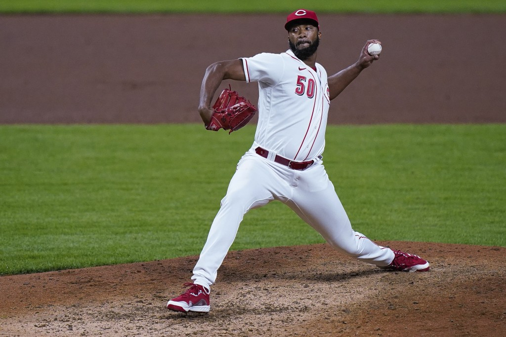 Cincinnati Reds relief pitcher Amir Garrett throws during the ninth inning of the team's baseball game against the Pittsburgh Pirates in Cincinnati, T...