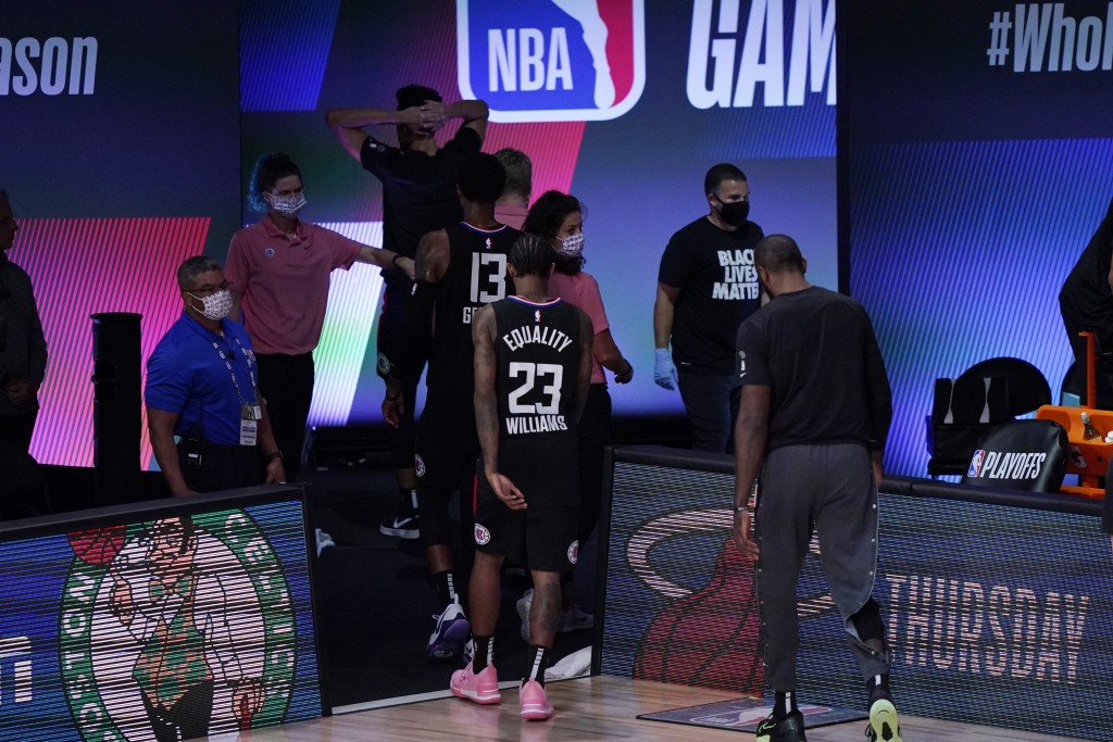 Los Angeles Clippers players walk off of the court following their loss to the Denver Nuggets in an NBA conference semifinal playoff basketball game T...