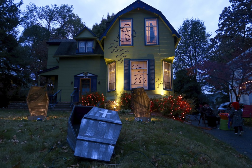 This 2017 photo released by Charles Fremont shows a home decorated for Halloween in Webster Groves, Mo. On a typical Halloween in the St. Louis suburb...