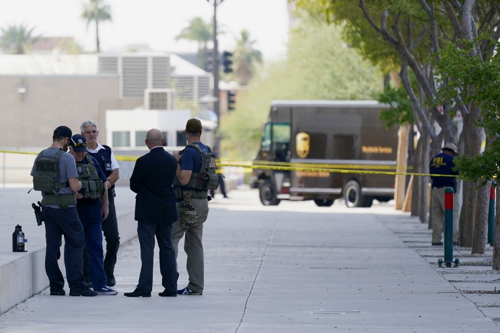 Federal law enforcement personnel stand outside the Sandra Day O'Connor Federal Courthouse Tuesday, Sept. 15, 2020, in Phoenix. A drive-by shooting wo...