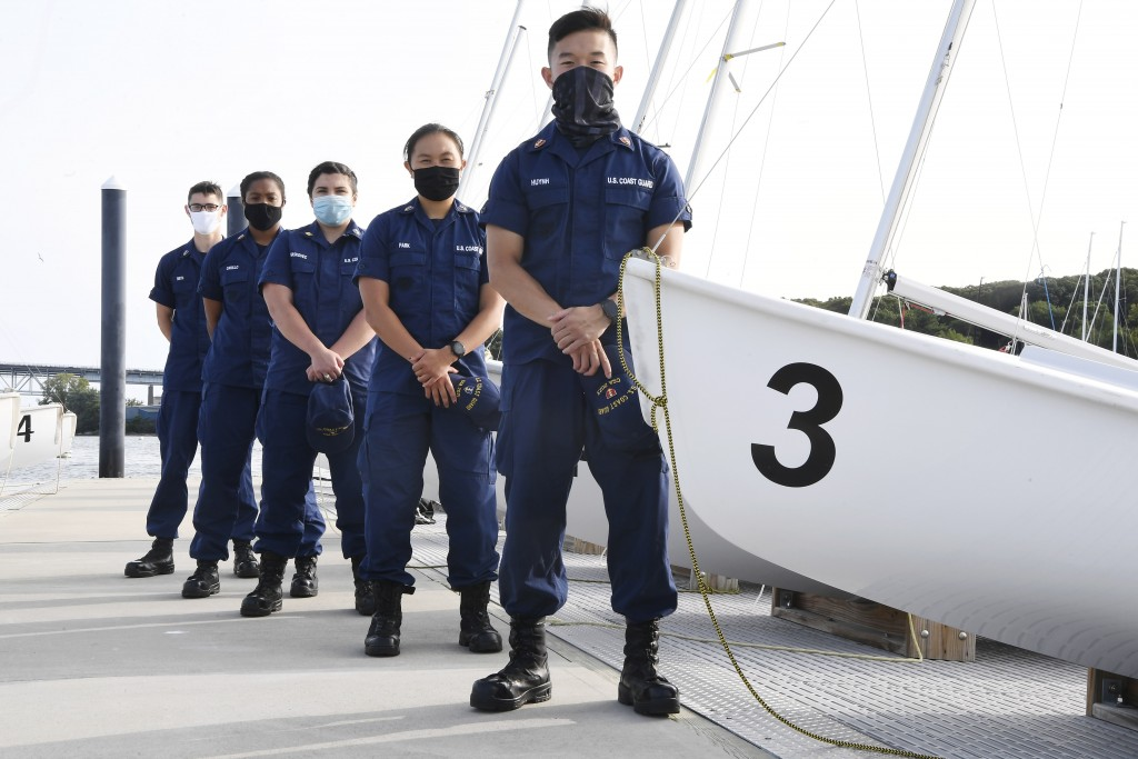 In this Monday Sept. 14, 2020 photo, From back left, Coast Guard Academy Cadets Henry Smith, Branyelle Carillo, Mia Haskovec, Jordan Park, and Tyler H...
