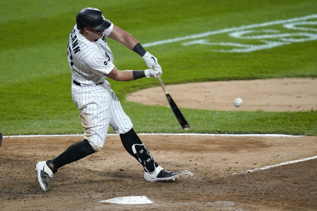 Chicago White Sox's James McCann hits a home run off Minnesota Twins relief pitcher Jorge Alcala during the seventh inning of a baseball game Tuesday,...