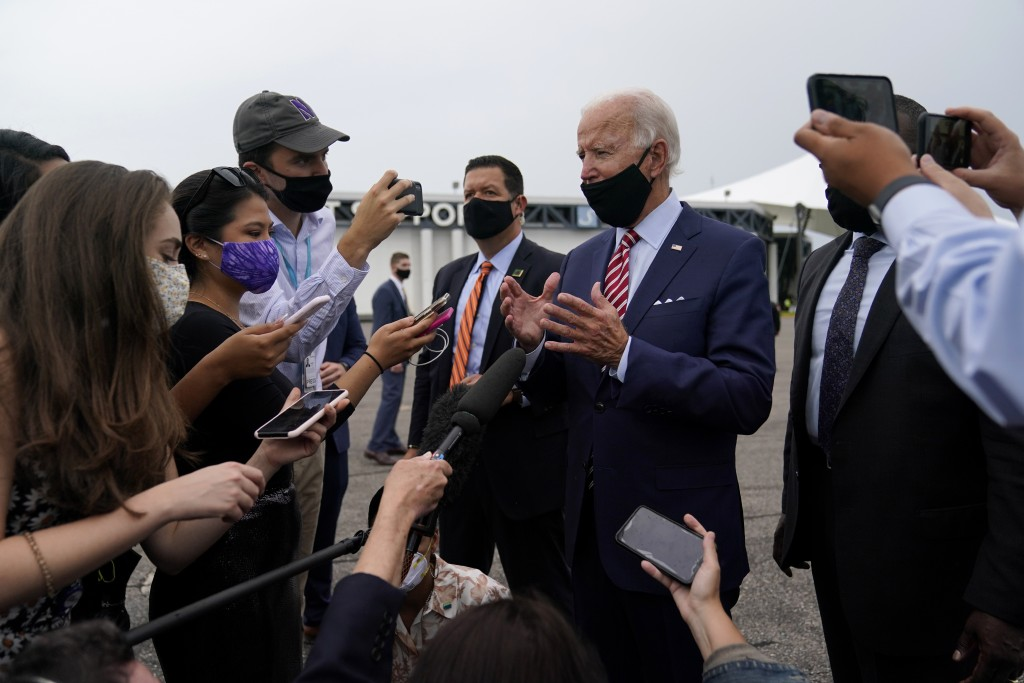 Democratic presidential candidate former Vice President Joe Biden speaks with reporters before boarding a plane at Tampa International Airport in Tamp...