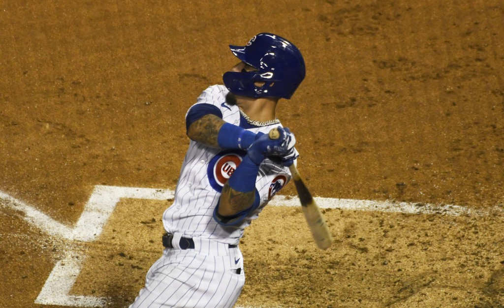 Chicago Cubs' Javier Baez (9) hits a home run against the Cleveland Indians during the second inning of a baseball game, Tuesday, Sept.15, 2020, in Ch...