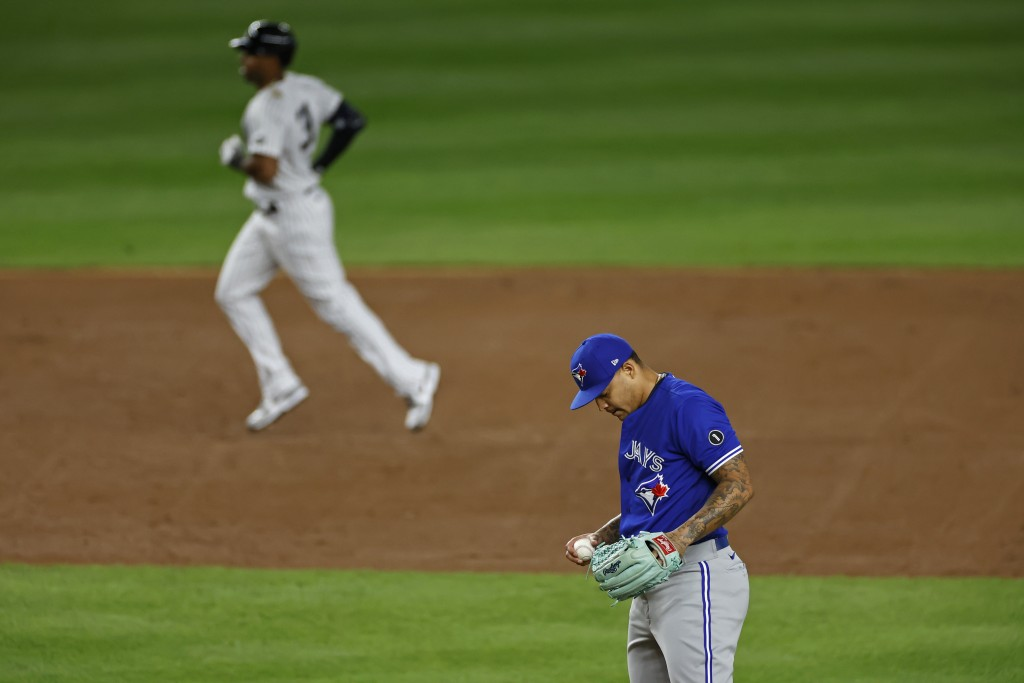 Toronto Blue Jays pitcher Taijuan Walker waits after giving up a solo home run to New York Yankees' Aaron Hicks during the second inning of a baseball...