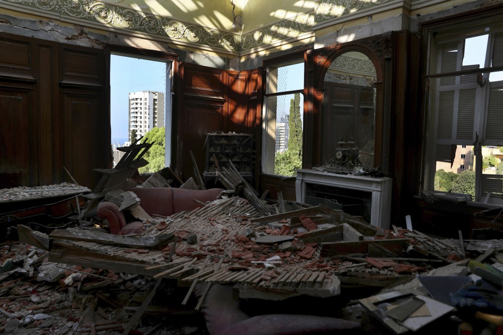 Debris from the ceiling and walls cover the floor of a room in the 150-year-old Sursock Palace, that was damaged by the Aug. 4 explosion that hit the ...