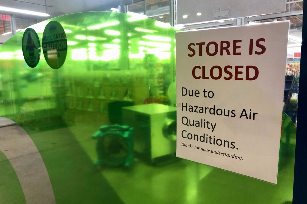 A sign at a Whole Foods in Lake Oswego, Ore., advises that the store is closed due to poor air quality Monday, Sept. 14, 2020. Another sign said all W...
