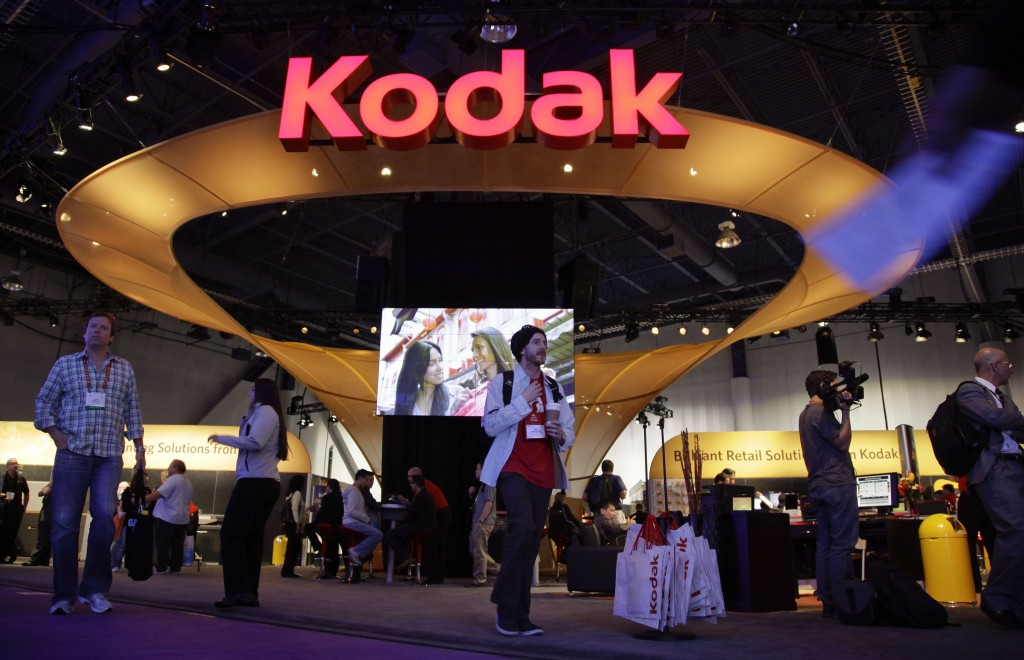 FILE - In this Jan. 11, 2012 file photo, buyers and industry affiliates pass by the Kodak exhibit at the 2012 International CES trade show in Las Vega...