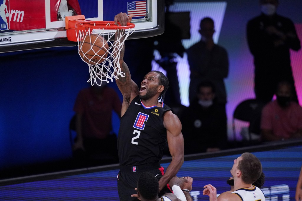 Los Angeles Clippers forward Kawhi Leonard (2) scores against the Denver Nuggets during the first half of an NBA conference semifinal playoff basketba...