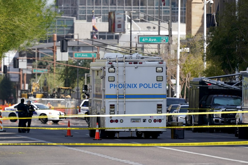 The Phoenix Police Department close off a street during an investigation outside the Sandra Day O'Connor U.S. Courthouse in Phoenix, on Tuesday, Sept....