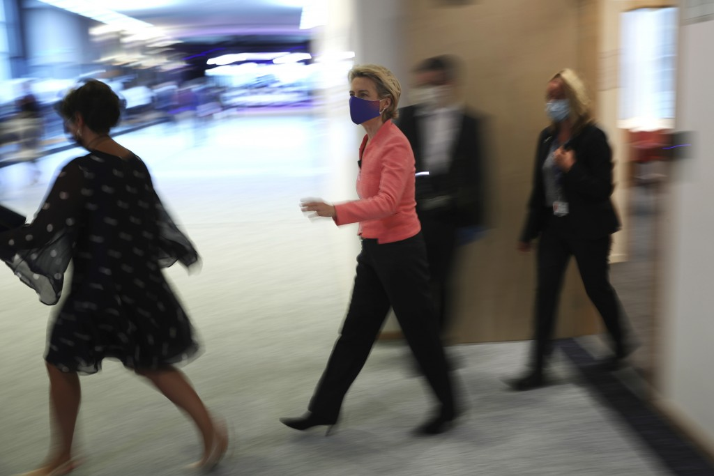 European Commission President Ursula von der Leyen, center, arrives for a plenary session ahead of her first State of the Union speech at the European...