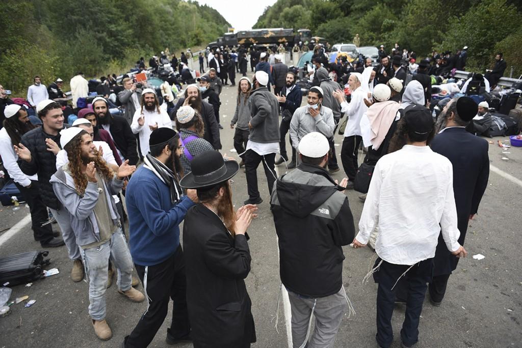 Jewish pilgrims dance as they gather on the Belarus-Ukraine border, in Belarus, Tuesday, Sept. 15, 2020. About 700 Jewish pilgrims are stuck on Belaru...