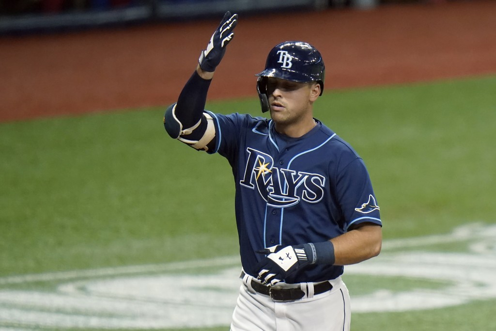 Tampa Bay Rays' Nate Lowe celebrates his solo home run off Washington Nationals starting pitcher Anibal Sanchez during the second inning of a baseball...