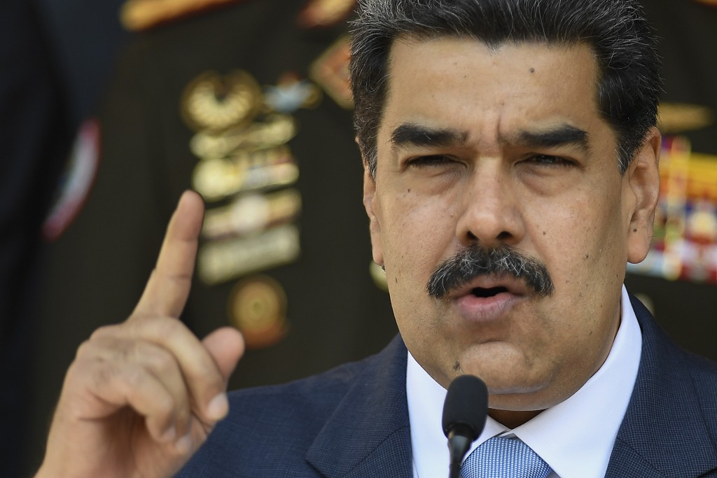 FILE - In this March 12, 2020 file photo, Venezuelan President Nicolas Maduro gives a press conference at Miraflores presidential palace in Caracas, V...