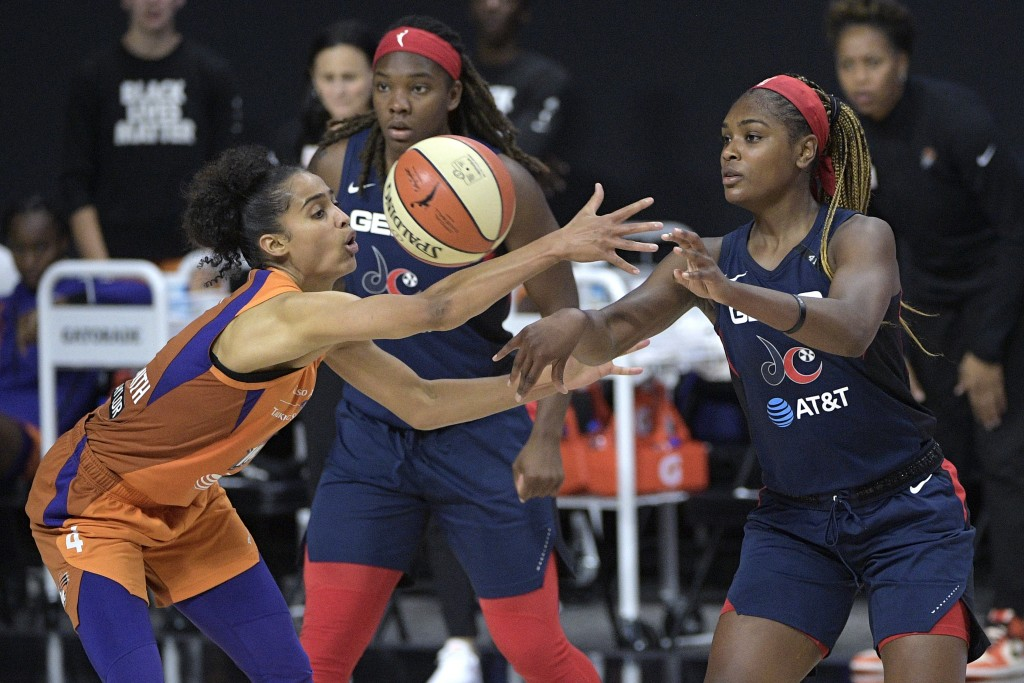 Washington Mystics guard Kiara Leslie, right, passes the ball in front of Phoenix Mercury guard Skylar Diggins-Smith (4) during the second half of a W...