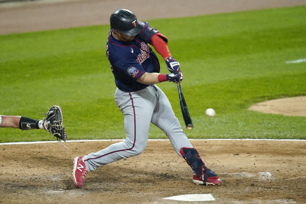 Minnesota Twins' Ryan Jeffers grounds out to Chicago White Sox second baseman Nick Madrigal, scoring Byron Buxton during the fifth inning of a basebal...