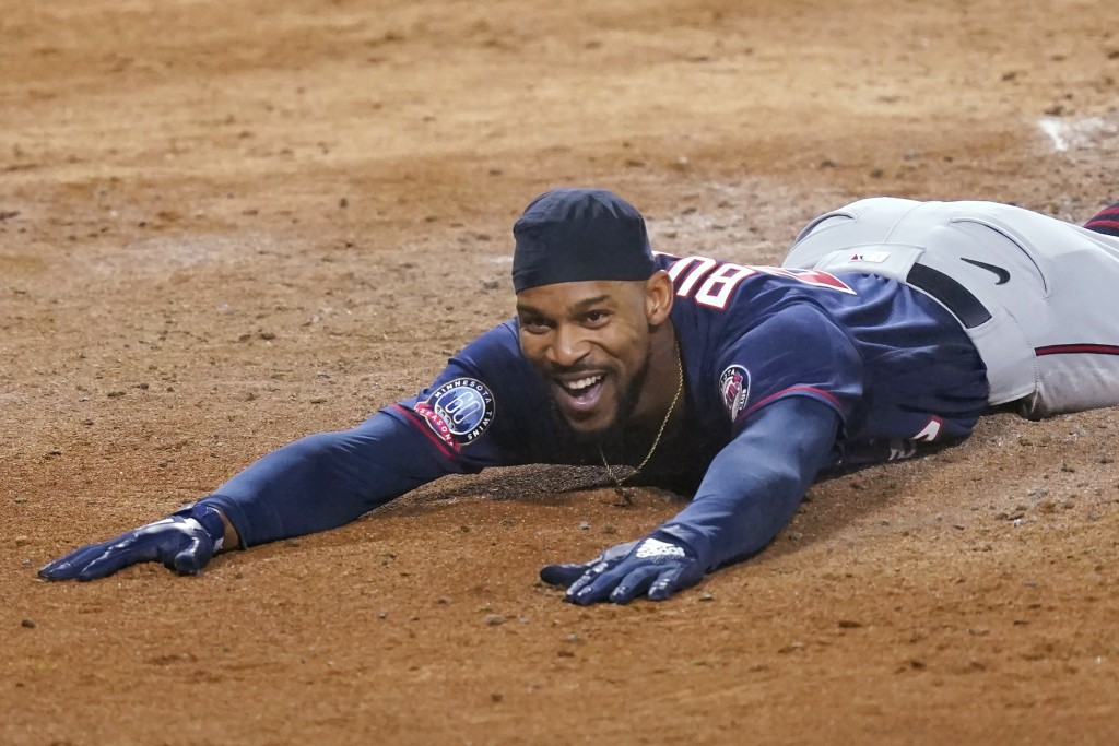 Minnesota Twins' Byron Buxton smiles after scoring on an inside-the-park home run during the third inning of the team's baseball game against the Chic...