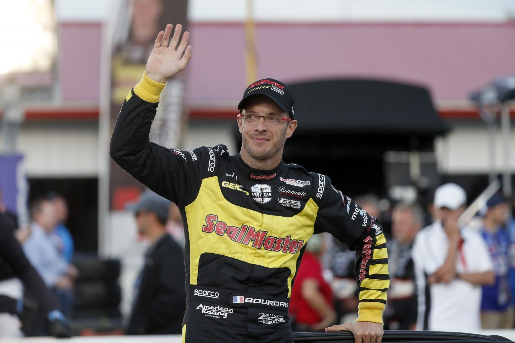 FILE - Sebastien Bourdais waves before the IndyCar auto race at World Wide Technology Raceway on Saturday, Aug. 24, 2019, in Madison, Ill. Sebastien B...