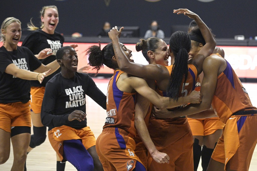 Phoenix Mercury guard Shey Peddy (5) is swarmed by teammates after Peddy scored the game-winning shot as time expired during a WNBA basketball first-r...