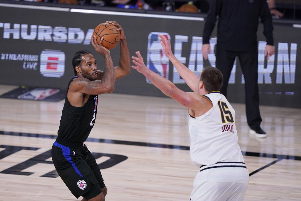 Los Angeles Clippers forward Kawhi Leonard (2) shoots over Denver Nuggets center Nikola Jokic (15) during the second half of an NBA conference semifin...