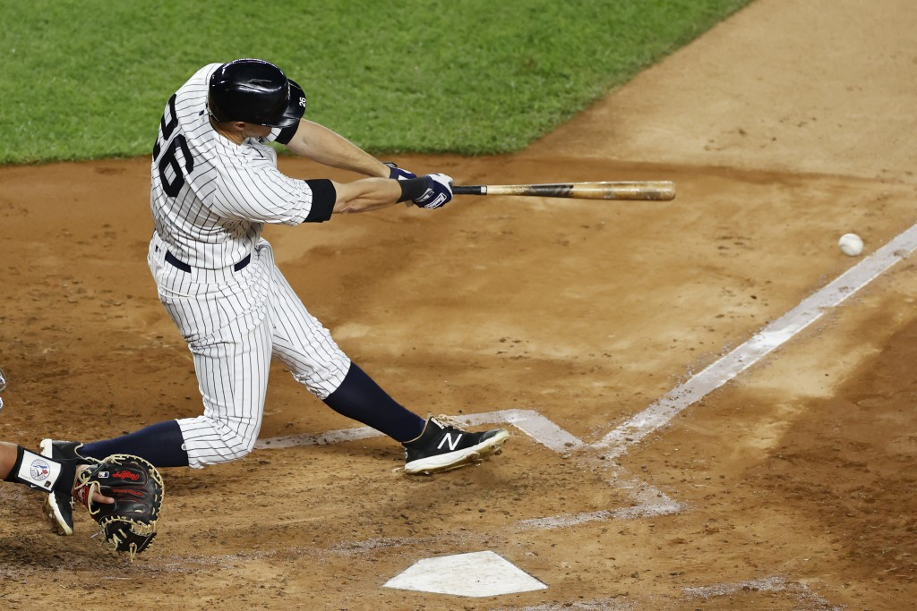 New York Yankees' DJ LeMahieu hits a three-run double during the third inning of the team's baseball game against the Toronto Blue Jays on Tuesday, Se...