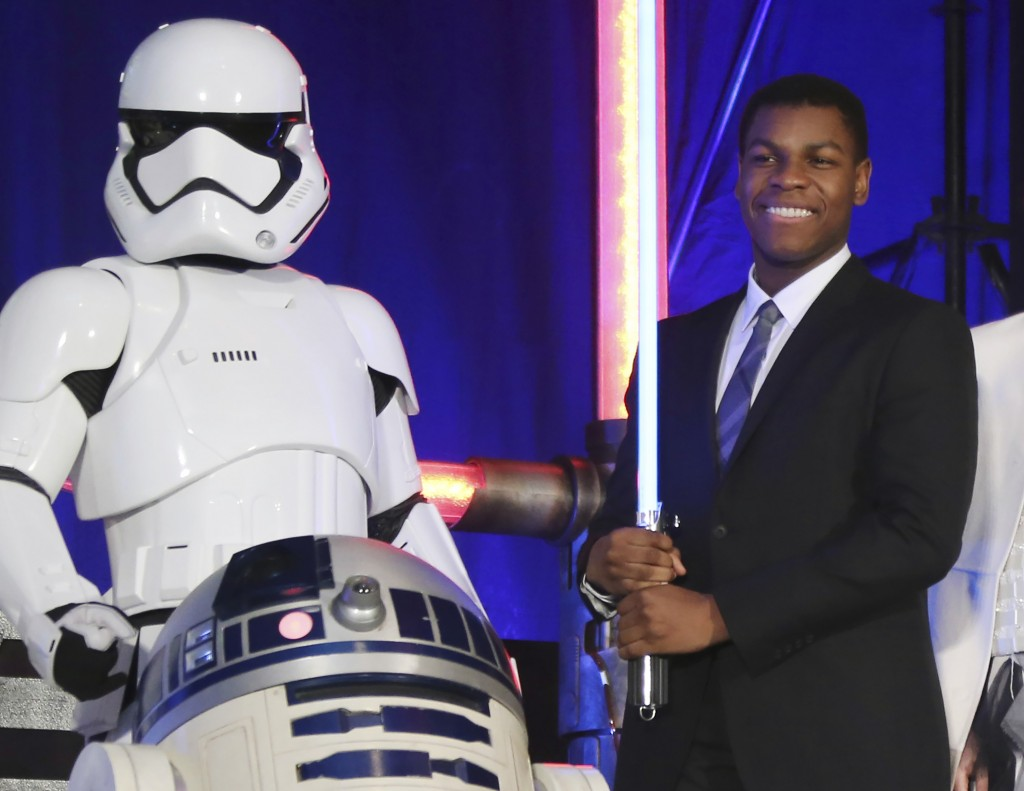 """FILE - In this Dec. 10, 2015 file photo, actor John Boyega, right, pose with Star Wars characters during the Japan Premiere of their latest film """"Star..."""