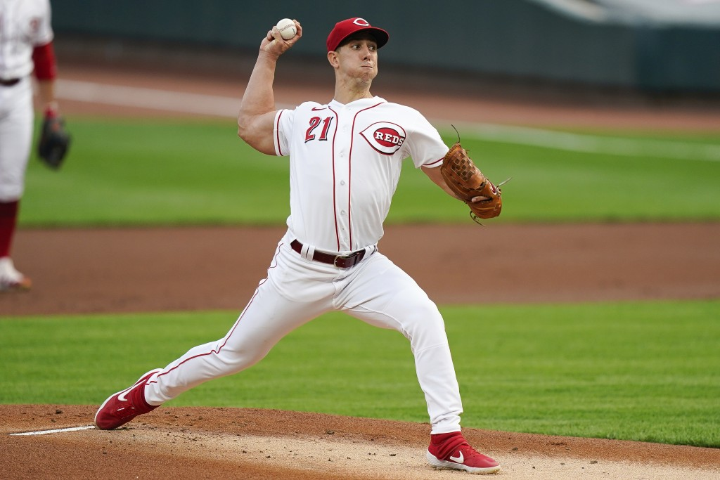 Cincinnati Reds' Michael Lorenzen pitches in the first inning of the team's baseball game against the against the Pittsburgh Pirates in Cincinnati, Tu...