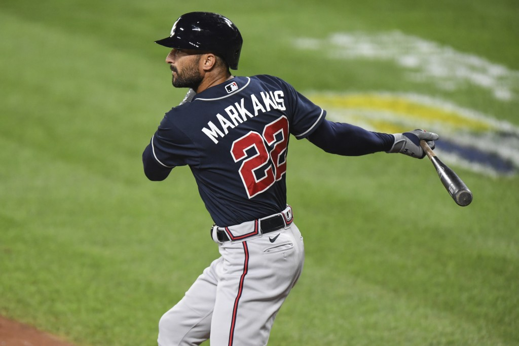 Atlanta Braves' Nick Markakis watches a double during the second inning of the team's baseball game against the Baltimore Orioles, Tuesday, Sept. 15, ...