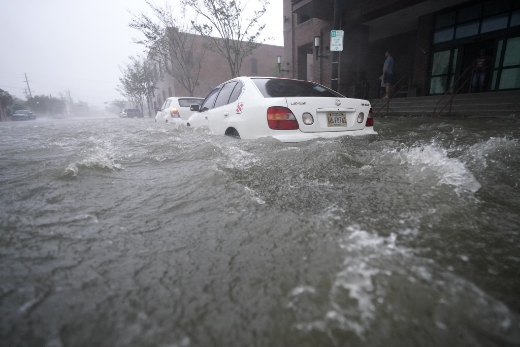 Floos waters move on the street, Wednesday, Sept. 16, 2020, in Pensacola, Fla. Hurricane Sally made landfall Wednesday near Gulf Shores, Alabama, as a...