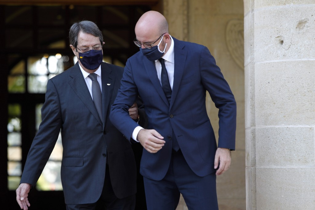European Union Council President Charles Michel, right, is greeted by Cyprus President Nicos Anastasiades at the entrance of the Presidential Palace i...