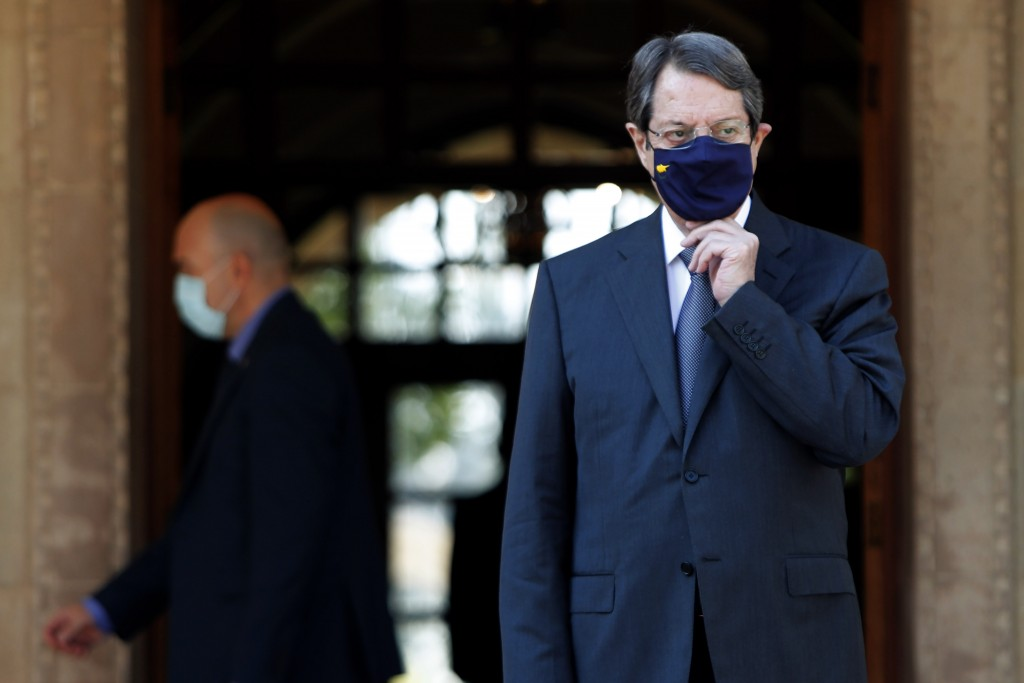 Cyprus President Nicos Anastasiades adjusts his health mask as wait the European Union Council President Charles Michel at the entrance of the Preside...