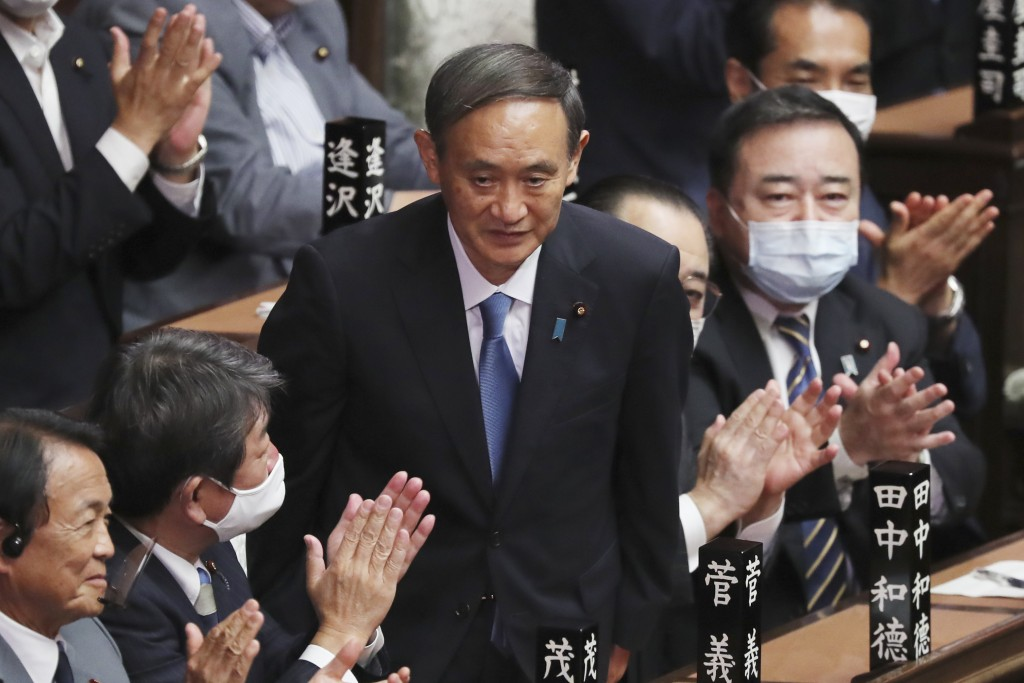 Yoshihide Suga is applauded after being elected as Japan's new prime minister at parliament's lower house in Tokyo, Wednesday, Sept. 16, 2020. Suga wa...