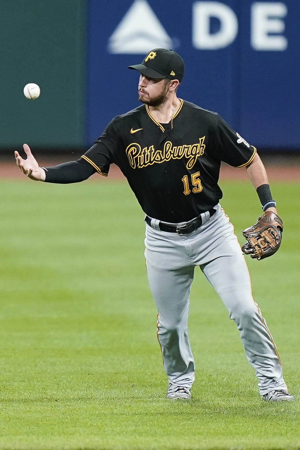 Pittsburgh Pirates shortstop JT Riddle fields the ball before throwing out Cincinnati Reds' Freddy Galvis at first base during the sixth inning of a b...